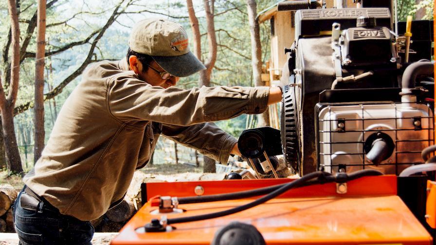 Woodworker Tak Yoshino using LT15 portable sawmill