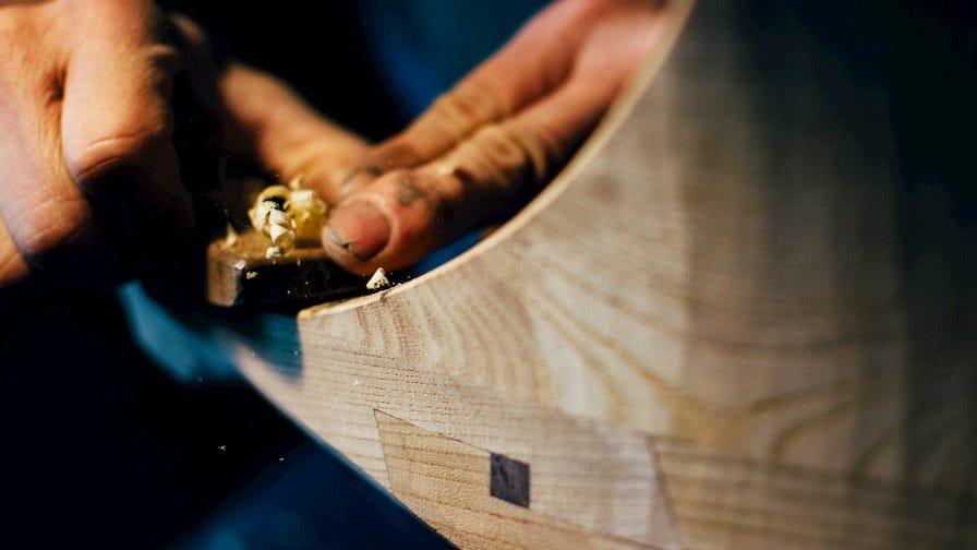 Woodworker Tak Yoshino carving wood